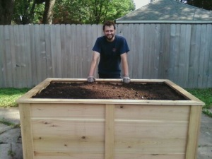 Nick, our construction specialist, with a 6x4x3 raised garden bed for placement atop a concrete slab that used to be a garage.